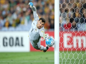 MAT RYAN of Australia saves a goal during the 2018 FIFA World Cup Asian Playoff match between the Australian Socceroos and Syria at ANZ Stadium in Sydney, Australia.