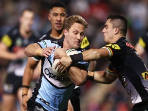 MATT MOYLAN of the Sharks beats the defence to score a try during the NRL match between the Panthers and the Sharks at Panthers Stadium in Penrith, Australia.