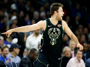 MATTHEW DELLAVEDOVA of the Milwaukee Bucks runs down the floor after scoring against the Philadelphia at Wells Fargo Center in Philadelphia, Pennsylvania.