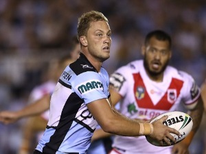 MATTHEW MOYLAN of the Sharks runs the ball during the NRL match between the Cronulla Sharks and the St George Illawarra Dragons at Southern Cross Group Stadium in Sydney, Australia.