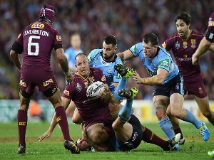 MATTHEW SCOTT of the Maroons offloads during the State Of Origin series between the Queensland Maroons and the New South Wales Blues at Suncorp Stadium in Brisbane, Australia.
