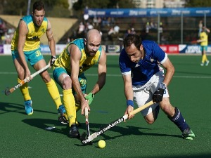 PIETER VAN STRAATEN of France and MATTHEW SWANN of Australia battle for possession during day 2 of the FIH Hockey World League Semi Finals Pool A match between Australia and France at Wits University in Johannesburg, South Africa.