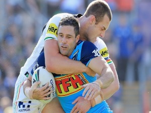 MICHAEL GORDON of the Titans is tackled by Isaac Yeo of the Panthers during the NRL match between the Penrith Panthers and the Gold Coast Titans in Penrith, Australia.