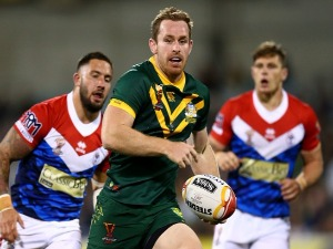 MICHAEL MORGAN of Australia makes a line break during the 2017 Rugby League World Cup match between Australian Kangaroos and France at Canberra Stadium in Canberra, Australia.