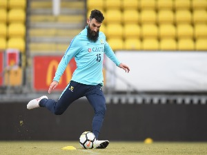 MILE JEDINAK in action during an Australian Socceroos training at Arasen Stadion in Oslo, Norway.