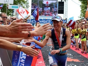 MIRINDA CARFRAE of Australia celebrates winning the women's race of Ironman Austria in Klagenfurt, Austria.