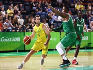 MITCH NORTON of Australia controls the ball during the Preliminary Basketball round match between Australia and Nigeria on day five of the Gold Coast 2018 Commonwealth Games at on the Cairns, Australia.