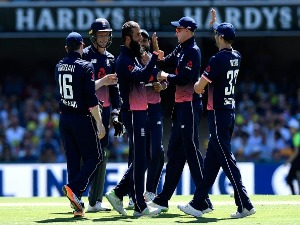 MOEEN ALI of England celebrates taking the wicket of David Warner of Australia during game two of the One Day International series between Australia and England at The Gabba in Brisbane, Australia.