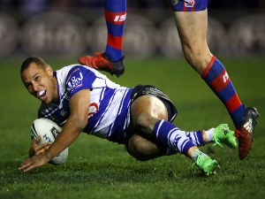 MOSES MBYE of the Bulldogs scores the winning try during the NRL match between the Canterbury Bulldogs and the Newcastle Knights at Belmore Sports Ground in Sydney, Australia.