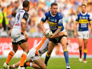 NATHAN BROWN of the Eels is tackled during the NRL match between the Wests Tigers and the Parramatta Eels at ANZ Stadium in Sydney, Australia.