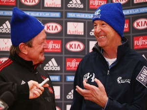 NEALE DANIHER (R) speaks to media alongside Kevin Sheedy during an Essendon Bombers AFL media and training session at True Value Solar Centre in Melbourne, Australia.
