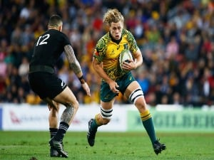 Australia's NED HANIGAN runs with the ball during the Bledisloe Cup match between the Australian Wallabies and the New Zealand All Blacks at Suncorp Stadium in Brisbane, Australia.