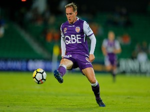 NEIL KILKENNY of the Perth Glory kicks the ball into the square during the A-League match between the Perth Glory and the Brisbane Roar at nib Stadium in Perth, Australia.