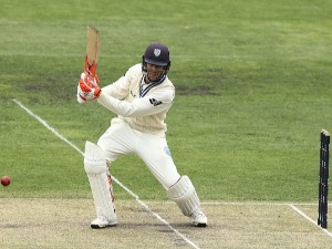 NIC MADDINSON of NSW bats during day three of the Sheffield Shield match between New South Wales and Tasmania at Blundstone Arena in Hobart, Australia.
