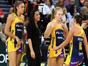 Coach NOELINE TAURUA of the Lightning talks to her players at the timeout during the Super Netball Grand Final match between the Lightning and the Giants at the Brisbane Entertainment Centre in Brisbane, Australia.
