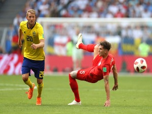 OLA TOIVONEN of Sweden and John Stones of England compete for the ball between Sweden and England in Samara, Russia.