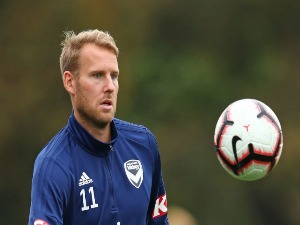 OLA TOIVONEN of the Victory trains away from the main group of players during training session in Melbourne, Australia.