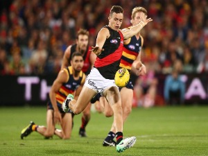 ORAZIO FANTASIA of the Bombers kicks the ball during the AFL match between the Adelaide Crows and the Essendon Bombers at Adelaide Oval in Adelaide, Australia.