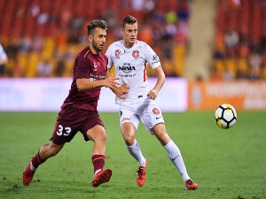 ORIOL RIERA of the Wanderers and Petros Skapetis of Brisbane contest the ball during the A-League match between the Brisbane Roar and the Western Sydney Wanderers at Suncorp Stadium in Brisbane, Australia.