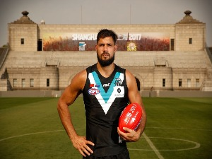 PADDY RYDER of the Power poses for a photograph during the Port Adelaide Power training session at Jiangwan Stadium in Shanghai, China.