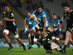 PATRICK TUIPULOTU of the Blues makes a break during the Super Rugby match between the Blues and the Hurricanes at Eden Park in Auckland, New Zealand.