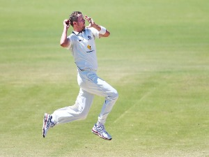 PETER SIDDLE of Victoria bowls during the Sheffield Shield match between Victoria and New South Wales at Junction Oval in Melbourne, Australia.