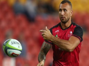QUADE COOPER of the Reds warms up before the Super Rugby match between the Reds and the Waratahs at Suncorp Stadium in Brisbane, Australia.