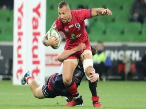 QUADE COOPER of the Reds runs with the ball during the Super Rugby match between the Melbourne Rebels and the Queensland Reds at AAMI Park in Melbourne, Australia.