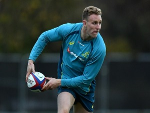 REECE HODGE of Australia looks for a pass during a training session at the Lensbury Hotel in London, England.