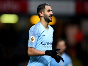 RIYAD MAHREZ of Manchester City celebrates after scoring his team's at the Premier League match between Watford FC and Manchester City at Vicarage Road in Watford, United Kingdom.