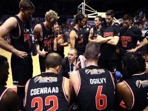 Hawks head coach ROB BEVERIDGE speaks to his players during a time out during the NBL match between the Illawarra Hawks and the Perth Wildcats in Wollongong, Australia.