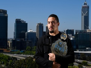 ROBERT WHITTAKER poses for a photo at Kings Park overlooking the Perth City skyline during a UFC 221 media opportunity in Perth, Australia.