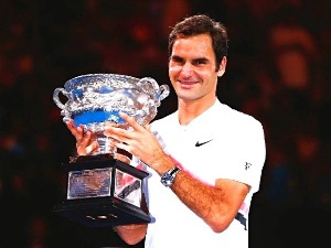 ROGER FEDERER of Switzerland poses with the Norman Brookes Challenge Cup after winning the 2018 Australian Open Men's Singles Final against Marin Cilic of Croatia at Melbourne Park in Australia.