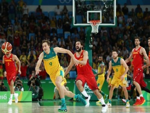 RYAN BROEKHOFF #9 of Australia attempts to make Australia shot at the basket during the Men's Basketball Bronze medal game between Australia and Spain of the Rio Olympic Games at Carioca Arena in Rio de Janeiro, Brazil.
