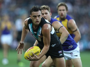 SAM POWELL-PEPPER of the Power controls the ball during the AFL match between the Port Adelaide Power and the West Coast Eagles at Adelaide Oval in Adelaide, Australia.