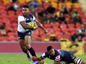 SAMU KEREVI of the Reds breaks away from the defence during the 2018 Global Tens match between the Queensland Reds and the Melbourne Rebels at Suncorp Stadium in Brisbane, Australia.