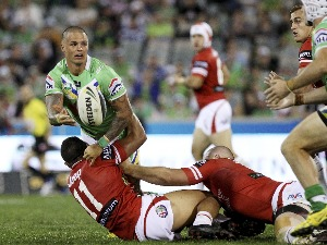 SANDOR EARL of the Raiders off loads the ball during the NRL match between the Canberra Raiders and the St George Illawarra Dragons at Canberra Stadium in Canberra, Australia.