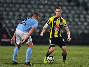 SCOTT GALLOWAY of the Phoenix makes a break during the A-League match between the Wellington Phoenix and Melbourne City FC at QBE Stadium in Auckland, New Zealand.