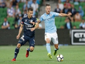 SCOTT JAMIESON of Melbourne City and Kosta Barbarouses of the Victory contest the ball during the A-League match between Melbourne City and Melbourne Victory at AAMI Park in Melbourne, Australia.
