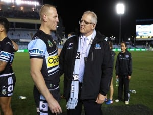 LUKE LEWIS of the Sharks celebrates after his 300th NRL match with Federal Treasurer SCOTT MORRISON during the NRL match between the Cronulla Sharks and the South Sydney Rabbitohs at Southern Cross Group Stadium in Sydney, Australia.
