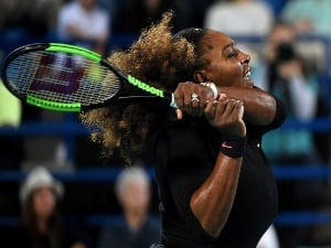 SERENA WILLIAMS of United States plays a backhand during her Ladies Final match of Mubadala World Tennis Championship in Abu Dhabi, United Arab Emirates.