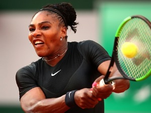 SERENA WILLIAMS of The United States plays a backhand during the ladies singles match against Julia Georges of Germany during day seven of the 2018 French Open at Roland Garros in Paris, France.