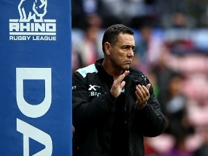 Sutherland Sharks coach SHANE FLANAGAN looks on during the Dacia World Club Challenge match between Wigan Warriors and Cronulla-Sutherland Sharks at DW Stadium in Wigan, England.
