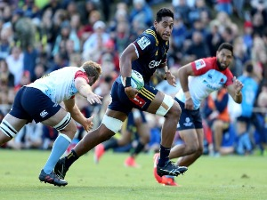 SHANNON FRIZELL of the Highlanders makes a break during the Super Rugby pre-season match between the Highlanders and the Waratahs in Queenstown, New Zealand.