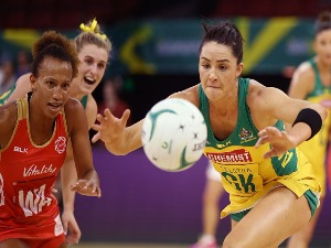 SHARNI LAYTON of the Diamonds competes for the ball with Serena Guthrie of the Roses during the International Test match between the Australian Diamonds and England at Adelaide Entertainment Centre in Adelaide, Australia.