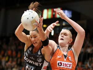 SHARNI LAYTON of the Magpies wins the ball over KRISTINA BRICE of the Giants during the Super Netball Major Semi Final match between the Giants and the Magpies at Sydney Olympic Park Sports Centre in Sydney, Australia.