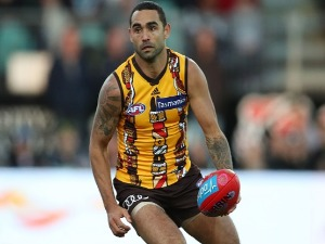 SHAUN BURGOYNE of the Hawks runs with the ball during the AFL match between the Hawthorn Hawks and the Port Adelaide Power at University of Tasmania Stadium in Launceston, Australia.