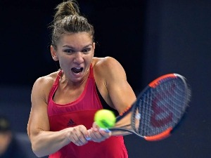 SIMONA HALEP of Romania in action against Caroline Garcia of France of the 2017 China Open at the China National Tennis Centre in Beijing, China.