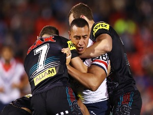 SIO SIUA TAUKEIAHO of the Roosters is tackled by the Panthers defence during the NRL match between the Penrith Panthers and the Sydney Roosters at Pepper Stadium in Sydney, Australia.