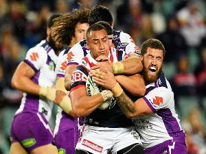 SIO SIUA TAUKEIAHO of the Roosters is tackled during the NRL match between the Sydney Roosters and the Melbourne Storm at Allianz Stadium in Sydney, Australia.